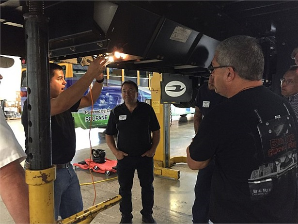 Maintenance personnel learn about servicing Blue Bird propane buses in a training session conducted by ROUSH CleanTech.