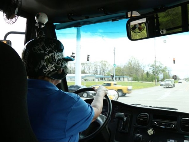 Dean Transportation is using virtual reality technology to supplement its training for drivers and attendants. Shown here is trainer Marcella Ozanich filming a segment of 360-degree video while driving, using a helmet fitted with a 360-degree camera mount.