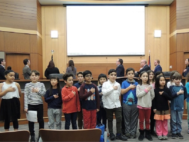 Third grade students from Hilltop Elementary School in Beachwood, Ohio, led the pledge of allegiance at aBeachwood City Council meeting on Dec. 17, before council members approved legislation to install seat belts on new school buses.