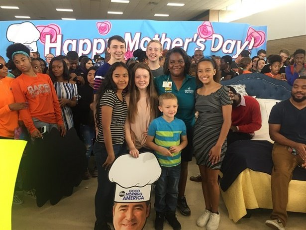 """Terrie Campbell, a driver for Hillsborough County (Fla.) Public Schools (pictured center),wonGood Morning America'sannual Mother's Day """"Breakfast in Bed"""" for her kindness towards students. Photo courtesy Tanya Arja"""