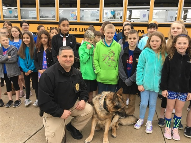 Students at Conewago Valley Intermediate School in New Oxford, Pennsylvania, decorated one of their school buses to honor McSherrystown Police Department's K-9 Officer Ozi(pictured center with Chief of Police Michael Woods) on March 7.