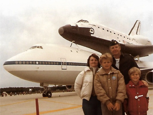 From 1967 to 1989, Dennis Masson, a METS school bus driver for Mona Shores Public Schools in Norton Shores, Mich., served as a lieutenant colonel and shuttle program administrator in the U.S. Air Force. He is shown here with his wife and two children.