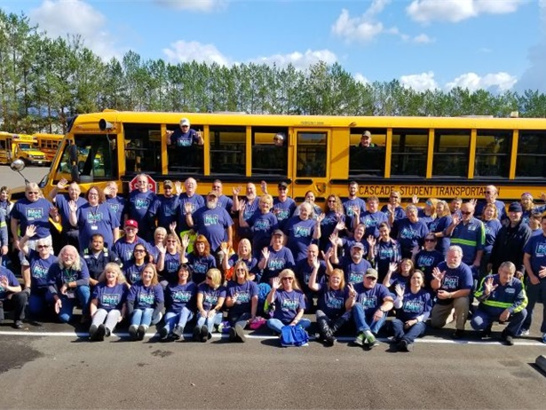 """STI's """"Bully-Free Buses"""" campaign starts with Blue Shirt Day. Shown here are employees at Cascade Student Transportation in Battle Ground, Washington, a member of the STI family of companies, wearing blue shirts in a show of solidarity against bullying."""