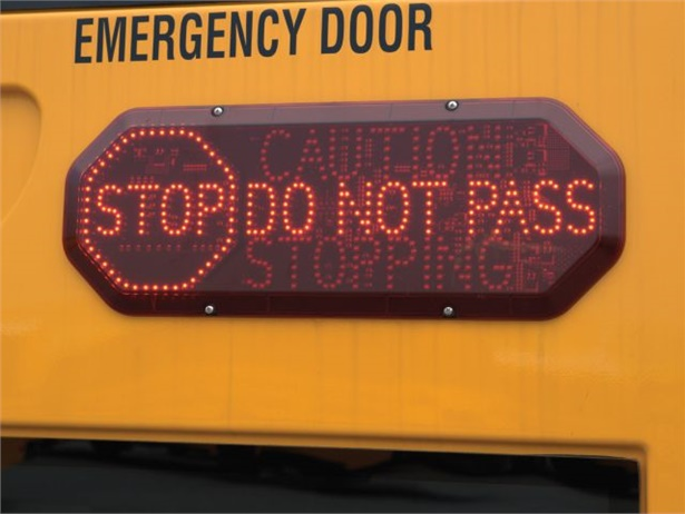 Michigan now allows school buses to be equipped with an electronic sign that alerts other drivers when the bus stops. Seen here is Safe Fleet's Driver Alert Lighting System.