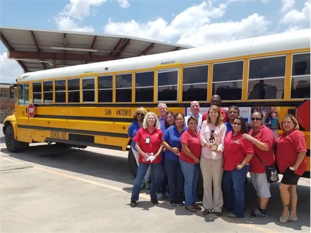 The safety training team at San Antonio Independent School District holds the Telly Award that they won for their student training video.