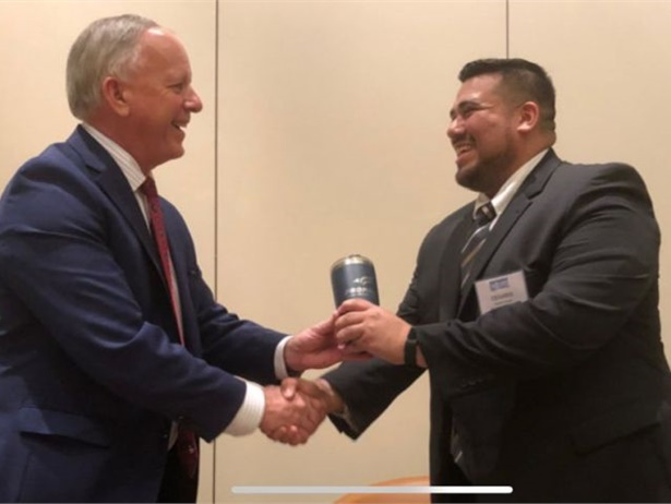 San Antonio (Texas) ISD was awarded a $1 million grant for propane school buses. Cesar Flores, director of local routes and field trips for the district (right), accepts the award from Thomas Perkins, president and CEO of the Propane Education and Research Council.