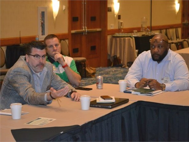 The roundtables at School Bus eXchange covered a variety of timely topics, one of which was alternative fuels in school transportation. Here, Kevin Kilner (left) of National Express shares his experience with alt-fuels.