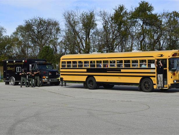 Jackson County (Mo.)Sheriff's Department police enacted a scenario with a disgruntled father forcing his way onto a school bus with a knife. Police showed how law enforcement would surround the bus and what they would say to negotiate with the assailant.