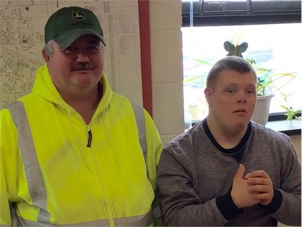 School bus driver Scott Reynolds worked for Fairport Central School District for 35 years. He is seen here with one of the students he drove, Ty Coppola, at a surprise retirement party.