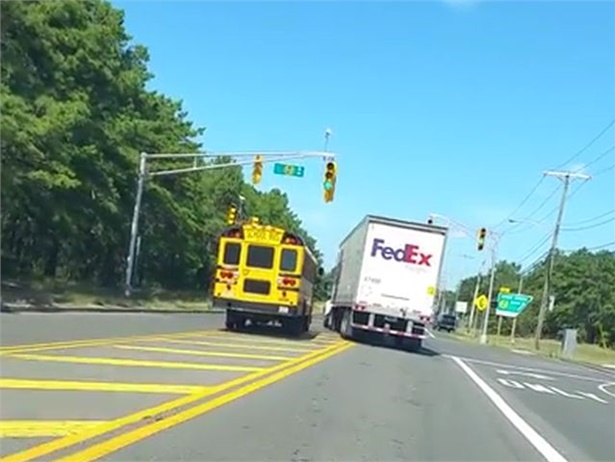 Police in Lakewood, New Jersey, say that a FedEx truck driver attempted to force a school bus off of the road as the bus driver tried to illegally pass him. Screenshot from video by Steve O'Connor