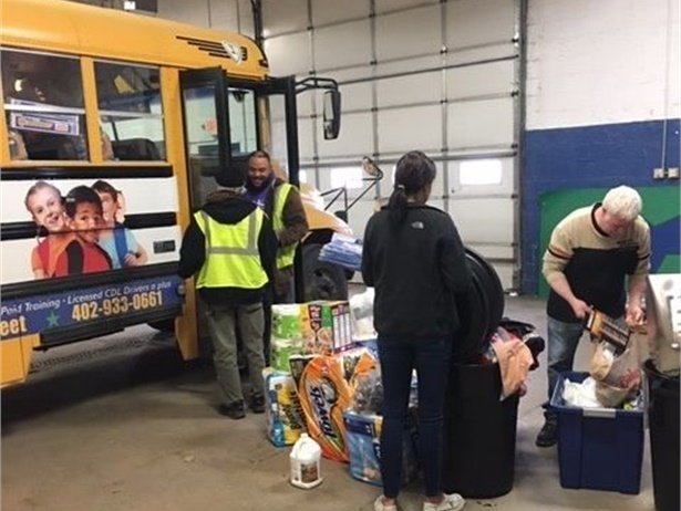 "About 150 STA employees in Omaha took part in a ""Stuff-the-Bus"" event, donating and collecting items for those affected by the major flood disasters in the state."