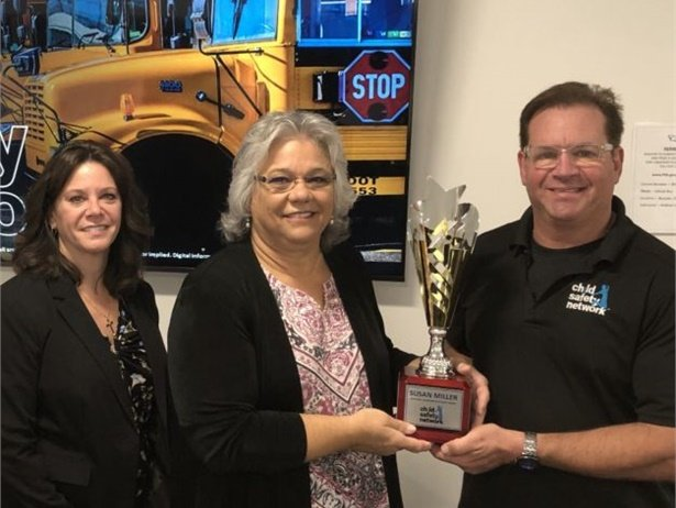 Susan Miller, Colorado's head of pupil transportation (center), receives an award for her school bus security training efforts from Ward Leber, the founder of Child Safety Network. Also shown is Andrea Di Spirito, a TSA trainer. Photo courtesy Child Safety Network
