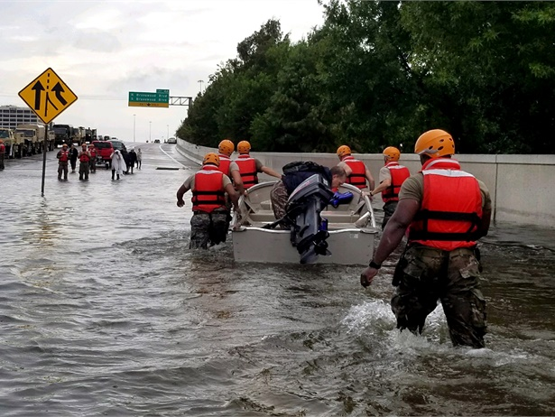 Daimler's U.S.-based subsidiaries, including the parent company of Thomas Built Buses, are partnering to donate $1 million to the American Red Cross. Shown here are soldiers with the Texas Army National Guard moving through flooded Houston streets. Photo courtesy U.S. Army photo by 1st Lt. Zachary West