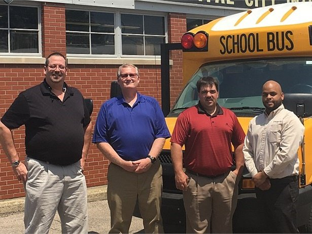 Capital City Bus Sales will be the exclusive dealer for sales and service of Trans Tech's full line of Type A school buses in the state of Michigan. Shown from left to right: Capital City Bus Sales representatives Tim Adams, Gary Bigelow, and Tim Pickman, and Trans Tech Sales Manager Erickson Lopez.