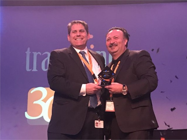 Schenectady (N.Y.) City School District won Transfinder's 2018 Ambassador of the Year award. Tony Civitella (right), Transfinder's president and CEO, presented the award to Laurence Spring, the district's superintendent.