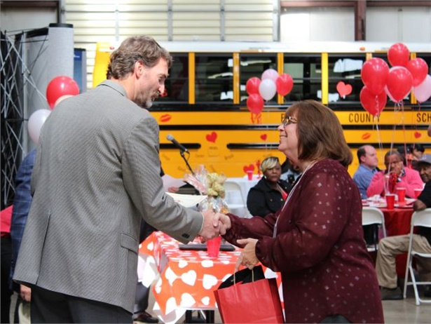 "State director Chad Carpenter congratulates Sue Takacs, who was named the 2017 Alabama ""Love the Bus"" Driver of the Year."