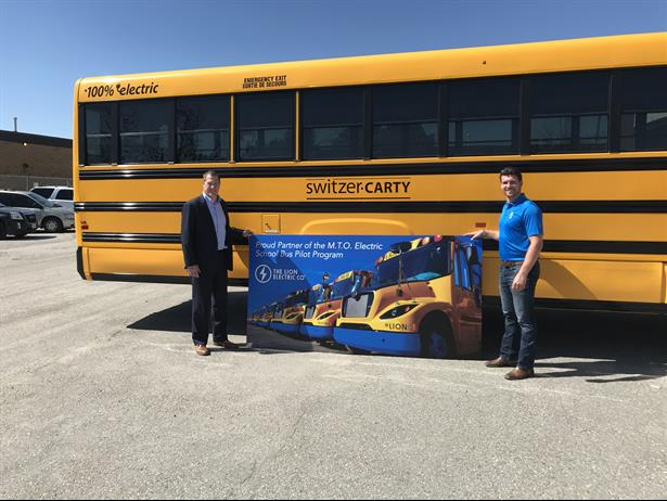 The Lion Electric Co. is delivering 13 electric school buses to Ontario operators in a pilot program. Shown here are Lion staff members with the bus forSwitzer-Carty Transportation.