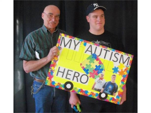 School bus driver Larry Eason (left) is pictured with one of his passengers, Alex Familo, who nominated Eason for a Friends of Autism award.