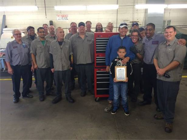 When Alex Mata (in blue jacket) interned with Denver Public Schools transportation, the team taught him about bus maintenance and even helped with his homework.