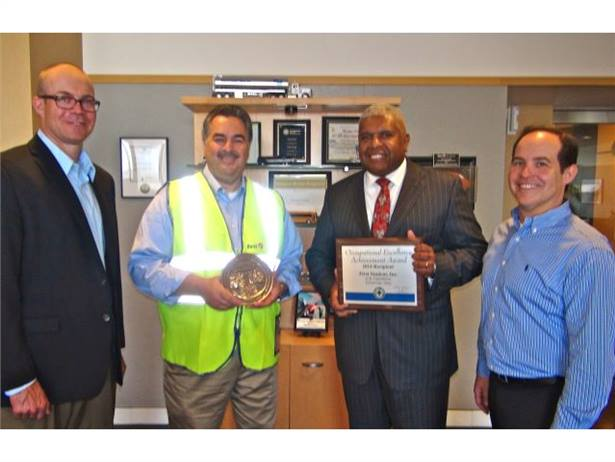 From left: Paul Gibson, National Safety Council; Gary Catapano, First Student's senior VP of safety; Dennis Maple, president of First Student; and Michael Pollock, National Safety Council.