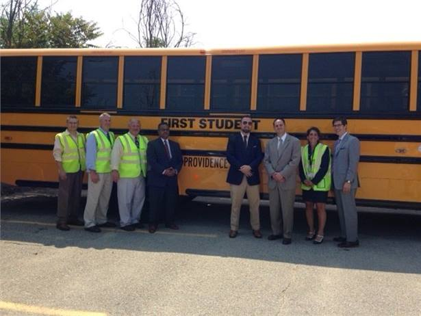 First Student staff and members of the Providence Public School District are pictured here in front of one of 70 new school buses being added to the fleet.