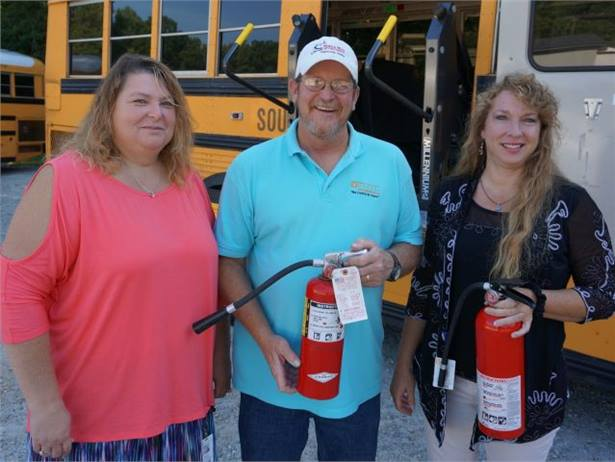 Greenville (S.C.) County Schools' Melanie MacDonald (right) is quick to acknowledge her colleagues Cathy Poole and John Weaver for their support when a school bus caught on fire.