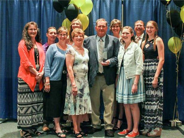 Harold Girardat (center) was honored for his contributions to the Pennsylvania School Bus Association. He was joined by his family and staff at the association's convention.