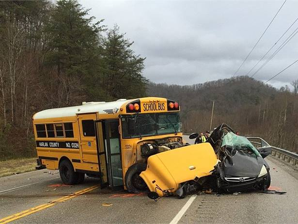 A motorist crossed the center line of the highway and struck a Harlan County, Kentucky, school bus head-on. The motorist was killed and the bus driver, student and teacher's aide aboard the bus were taken to the hospital. Photo by Kentucky State Police