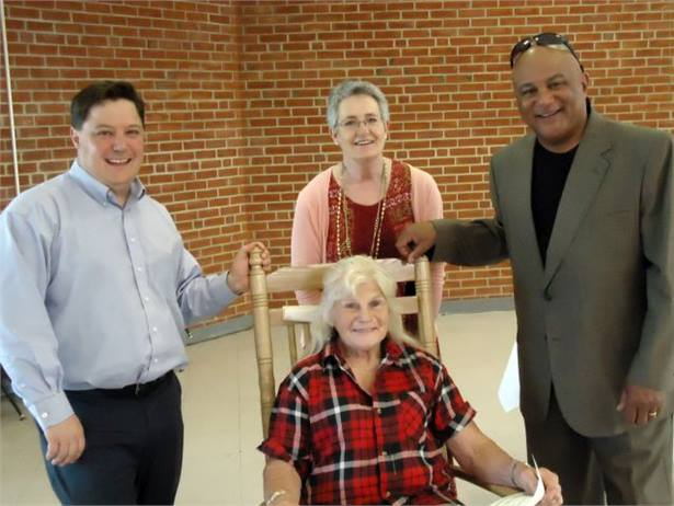 Lois King (seated), a driver for Fauquier County (Va.) Public Schools since 1960, was recognized at a transportation awards program. She is seen here with school board members Brian Gorg (left), Sheryl Wolfe and Duke Bland.