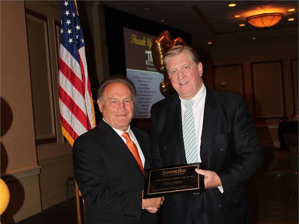 SCHOOL BUS FLEET magazine Publisher Frank Di Giacomo presented Student Transportation Inc. Founder, Chairman and CEO Denis J. Gallagher with its Contractor of the Year award.