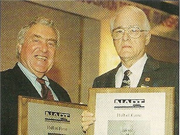 Bobit Business Media founder Ed Bobit (left) was inducted into the National Association for Pupil Transportation Hall of Fame in 1999. Also inducted that year was Buster Bynum, former pupil transportation director in Virginia.
