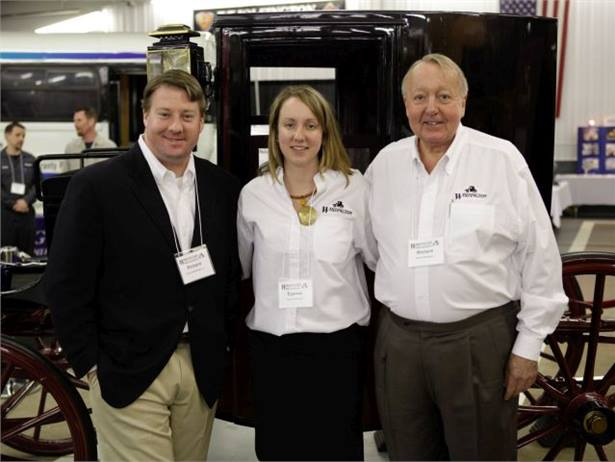 Richard Wolfington Sr. (right) is pictured here with son Richard Jr. and daughter Eganne Wolfington McGowan in 2011. Behind them is a restored 1898 Wolfington Brougham carriage.