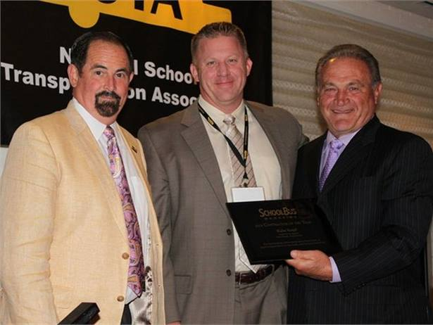 Blake Krapf (center) was SBF's Contractor of the Year in 2010. At left is Donnie Fowler, then-president of the National School Transportation Association. At right is SBF's Frank Di Giacomo.