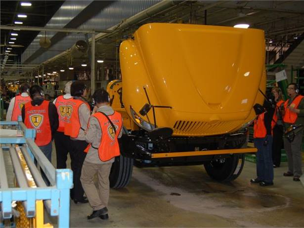 In a new partnership, IC Bus parent Navistar will develop and distribute school buses in China. Here, a Chinese delegation visits the IC Bus plant in Tulsa, Okla., in March.