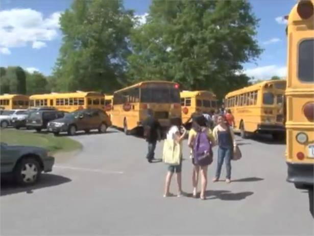Middle school students end up walking among the vehicles in the bus loop looking for the correct bus.
