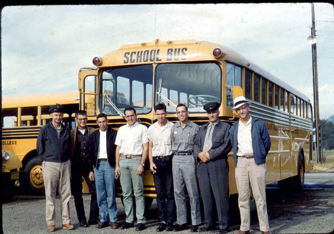 Another vintage shot submitted by Tom Carroll of Shasta Union High School District buses and staff.
