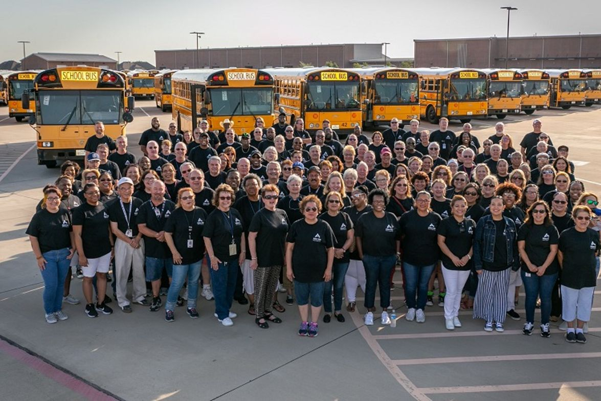The team also kicked off the school year with a cheerful group photo in front of the district's...