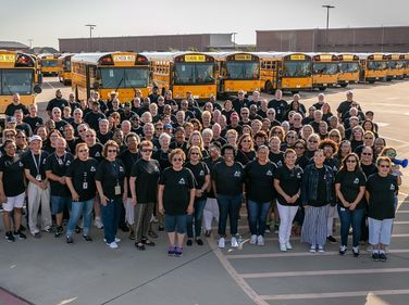 Theteam also kicked off the school year with a cheerful group photoin front of the district's...