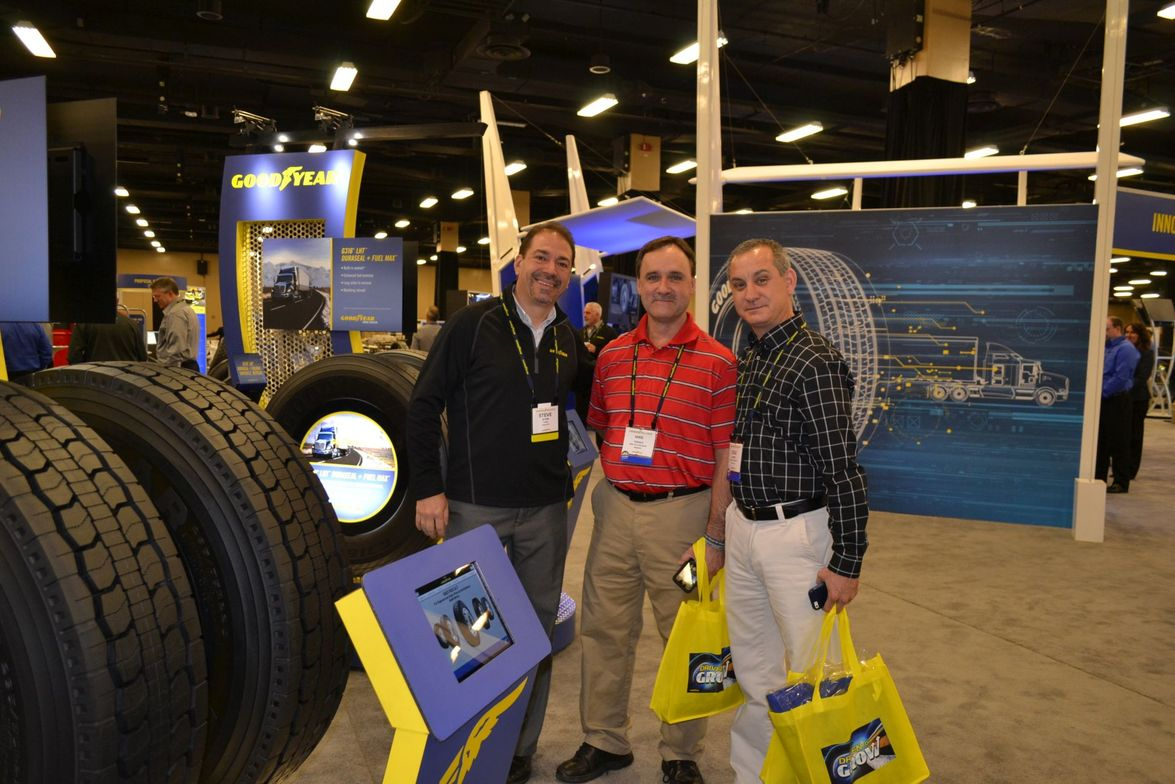 Mike Thomas (center) and Cole Fraser (right) from Black's Tire Service Inc. look over medium...