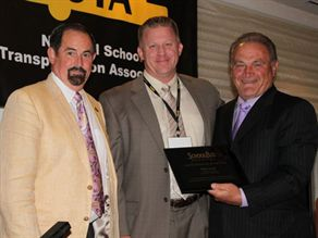 Blake Krapf (center) receives the Contractor of the Year award from SBF Publisher Frank Di Giacomo. At left is NSTA President Donnie Fowler.
