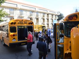Several school buses were also on display outside, including a Blue Bird Vision propane school...