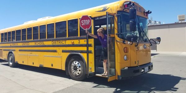 When unloading, do not step off the bus before sticking out the hand-held stop sign and checking...
