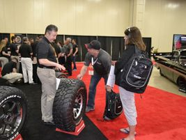 Les and Tina Foster, owners of a Big O Tires store in Gardner, Kan., talk to Chris Schaible, a...