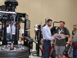Hunter Engineering Sales Representatives Matt Davison talks to Russ Bruggink during the Big O...