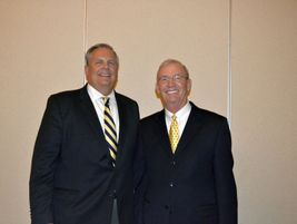 Greg Smith, publisher of Modern Tire Dealer, congratulates Norm Gaither on his induction into...