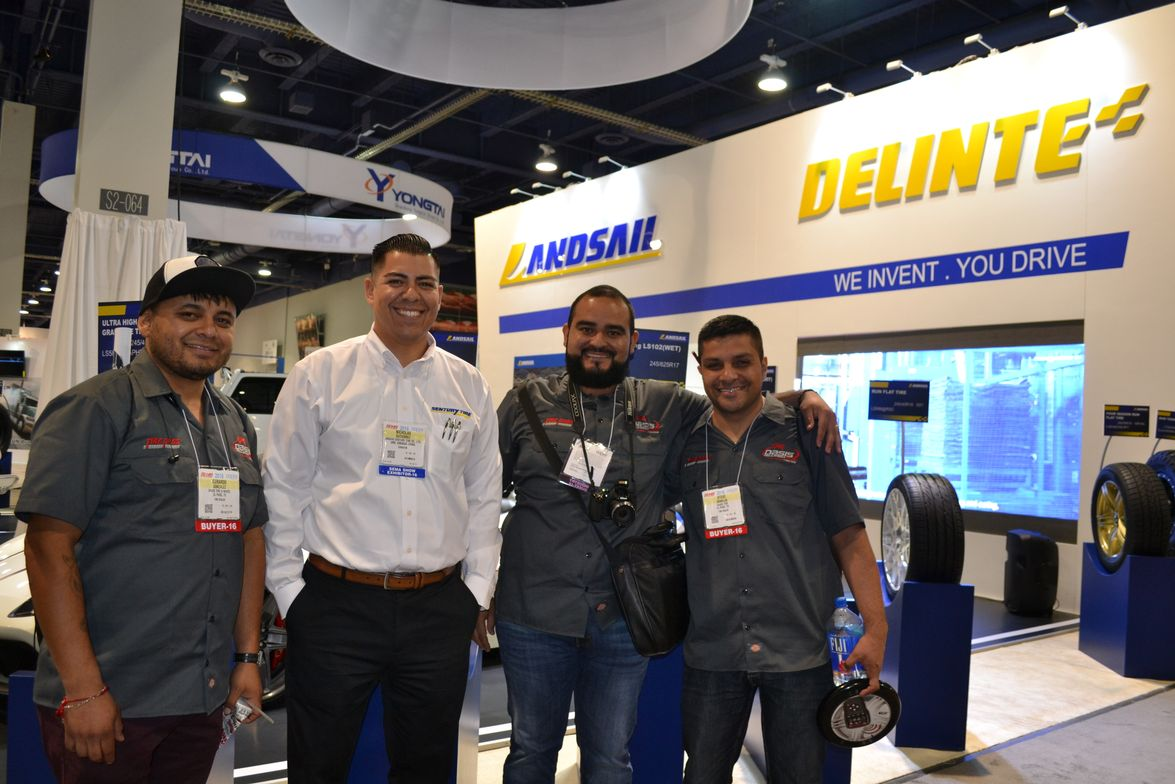 Nick Gutierrez, western regional sales manager for Sentury Tire Americas, visits with a team...