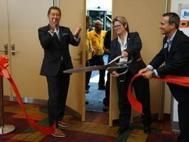 Bobit President/CEO Ty Bobit, IndyGo's Vicki Learn, and METRO GM James Blue cut the ribbon to...