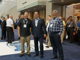 Pacific Coachways' Tom and Michael Giddens with UMA President/CEO Stacy Tetschner.