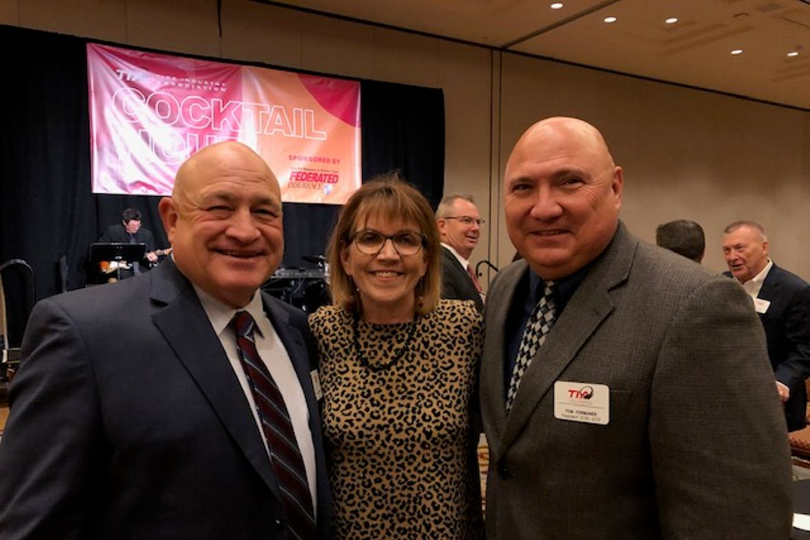 TIA Vice President Dan Nothdurft, his wife, Roxie, and TIA Past President Tom Formanek are ready...