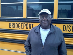 Veteran bus driver Leonard Davis was credited with keeping more than 50 students and staff members safe when a car collided with their bus.